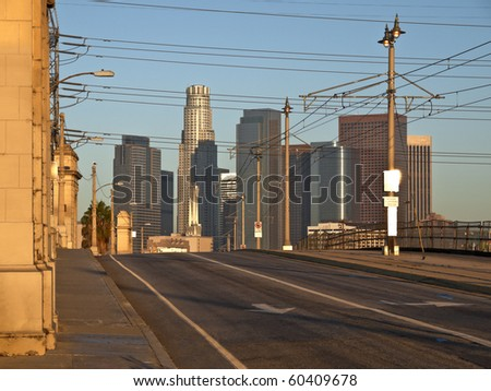 Downtown Los Angeles in warm sunrise light. - stock photo