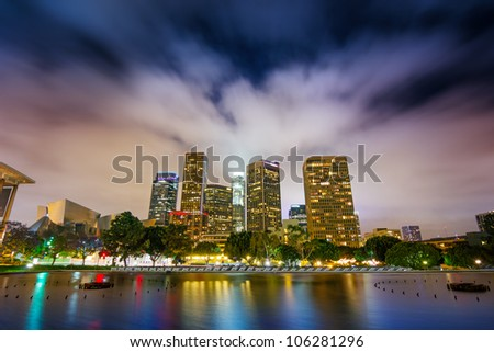 Downtown Los Angeles skyline reflects in water at night. - stock photo