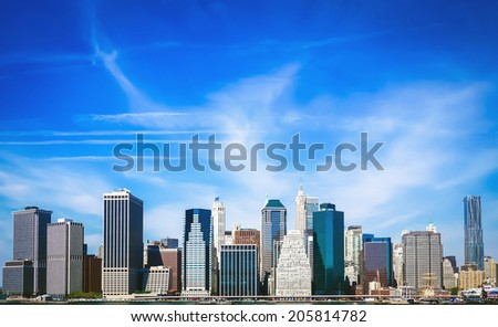 Downtown (Lower) Manhattan's Financial District as seen from across the East River from Brooklyn Bridge Park below Brooklyn Bridge. - stock photo