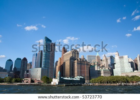 Downtown Manhattan city skyline viewed from a tour boat - stock photo
