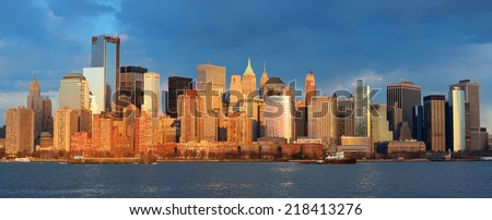Downtown Manhattan skyline at sunset over Hudson River in New York City