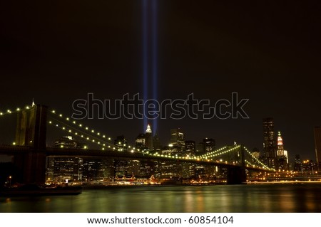 Downtown Manhattan with twin tower light beams, photographed on 9-11-2010 - stock photo