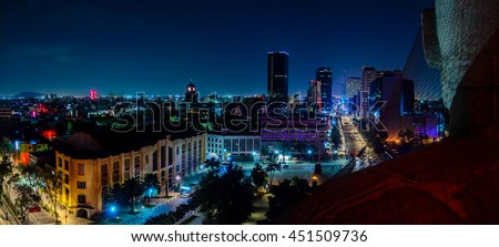 Downtown Mexico City skyline at night from top of the revolution monument - stock photo