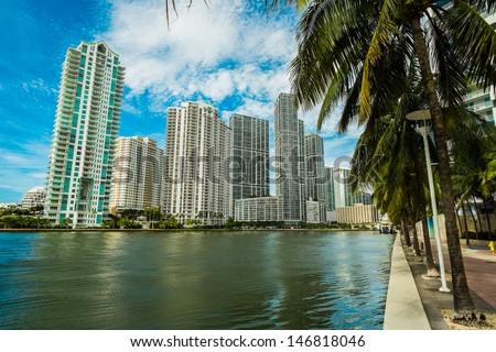 Downtown Miami along the Miami River inlet with Brickell Key in the background. - stock photo
