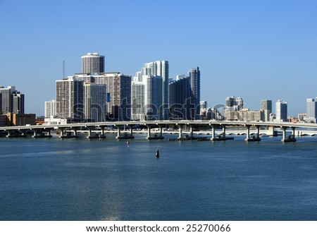 Downtown Miami Florida.  Biscayne Bay bridge shown in front of towering skyscrapers. - stock photo
