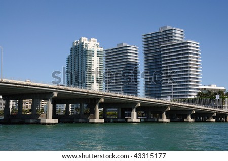 Downtown Miami with the Biscayne Bay Bridge in foreground, Florida USA - stock photo