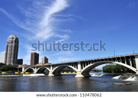 Downtown Minneapolis at left with Central Avenue (Minnesota 65) Bridge over Mississippi River - stock photo