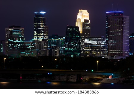 Downtown Minneapolis Minnesota at Night Time Overlooking the Mississippi River - stock photo