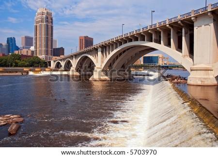 Downtown Minneapolis Minnesota Daytime - St Anthony Falls and 3rd Avenue bridge - stock photo