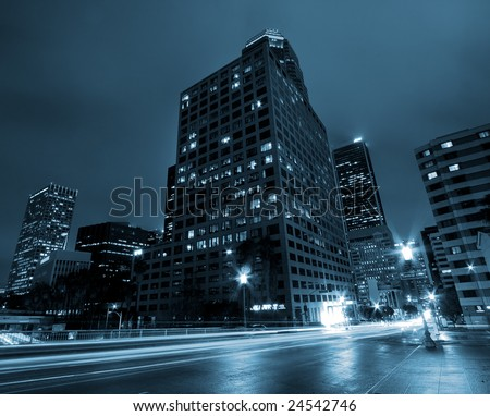 Downtown Modern Urban City at Night with Traffic and Buildings, Los Angeles - stock photo