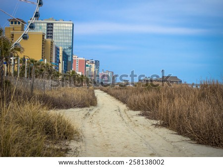 Downtown Myrtle Beach. The Atlantic Coast and beach path in downtown Myrtle Beach, South Carolina. - stock photo