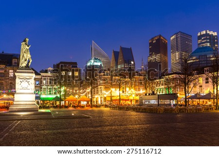 Downtown of The Hague Netherlands, with its monumental old buildings, and modern skyline in the background at dusk - stock photo