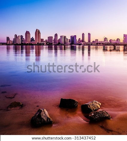 Downtown San Diego and San Diego Bay at sunrise. - stock photo