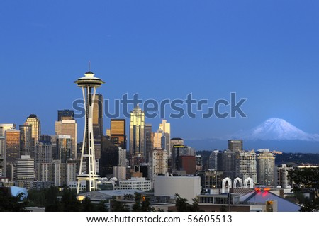 Downtown Seattle skyline with view of Mt. Rainier in the distance - stock photo