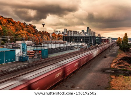 Downtown Seattle With Train In Motion.