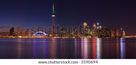 Downtown Toronto during pride week, from central island - stock photo
