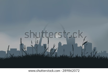 Dowtown St. Louis with a gray overcast sky and the sun peaking through the clouds.  - stock photo