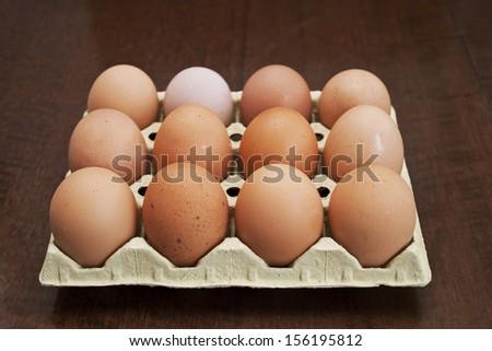 Dozen fresh brown hen eggs  - stock photo