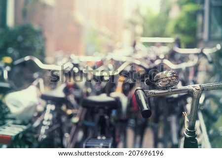 Dozens of parked bikes in an Amsterdam street - stock photo