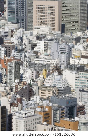 Dozens of tall buildings close together. - stock photo