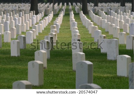 Dozens of unmarked military tombs - stock photo