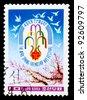 DPR KOREA - CIRCA 1987: A canceled stamp printed in DPR Korea (North Korea) shows image of Spring Arts Festival logo circa 1987 - stock photo