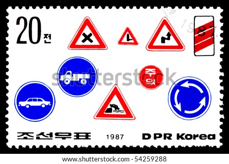 DPR KOREA - CIRCA 1987: A cancelled stamp printed in DPR Korea (North Korea) shows image of traffic signs circa 1987