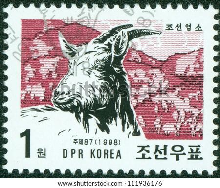 DPR KOREA - CIRCA 1998: A post stamp printed in DPR Korea (North Korea) shows farm animal goat, circa 1998 - stock photo