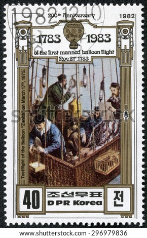 DPR KOREA - CIRCA 1982: A stamp printed in DPR KOREA shows hot air balloon,200th Anniversary of the first manned balloon flight Nov.21st, 1783, circa 1982 - stock photo