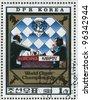 DPR KOREA - CIRCA 1980: A stamp printed in DPR KOREA shows Kurchnoi and Karpov playing chess. World Chess Championship, circa 1980 - stock photo