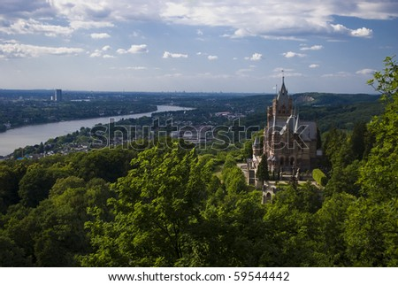 Drachenburg castle and the Rhine valley in spring - stock photo