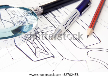 drafing of crane hook with pencil, pen and magnifier - stock photo