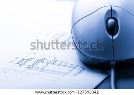 Drafting and computer mouse - stock photo