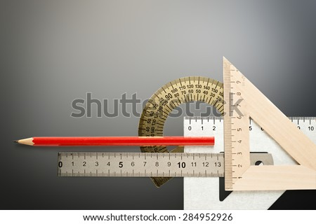 Drafting wooden and steel tools with pencil  - stock photo