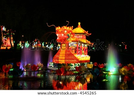 dragon and fountain at chinese lantern festival celebrating new years - stock photo