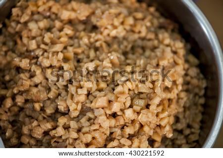 Dragon boat dumplings stuffing- Daikon Radish diced wrapped in  glutinous oil rice. - stock photo