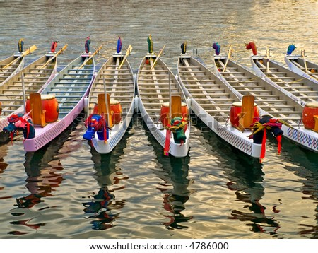 Dragon boats basking in a warm sunlight before the race - stock photo