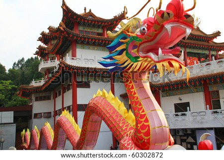 Dragon decoration outside a chinese temple. Concept of religious icon. - stock photo