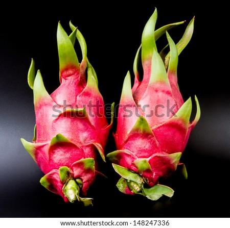 Dragon fruits on black background - stock photo