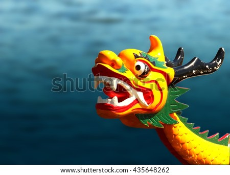 Dragon head on the dragonboat on the watter background - stock photo