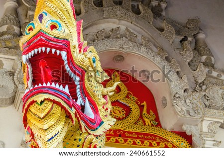 Dragon on gates of the Buddhist temple in Bangkok, Thailand - stock photo