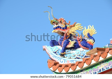 Dragon on the roof corner of Chinese temple - stock photo