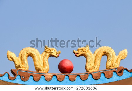 Dragon sculpture on the roof - stock photo