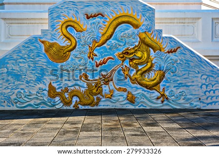 dragon statue china in the wall temple of blue color. - stock photo