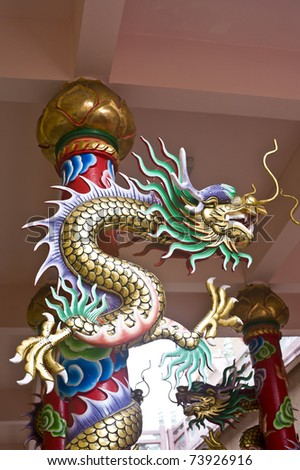 dragon statue in front of chinese temple