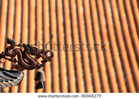 Dragon statue on roof of a temple - stock photo