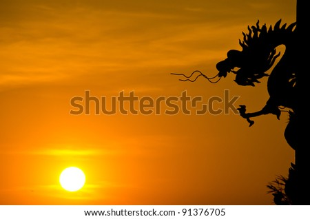 Dragon statue silhouette with sunset.
