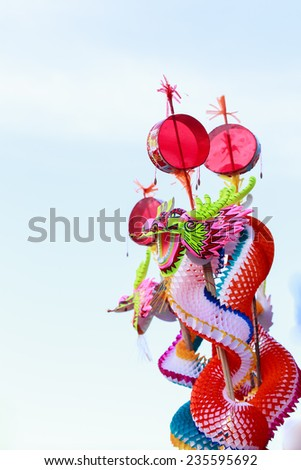 Dragon toy with sky backgroud - stock photo