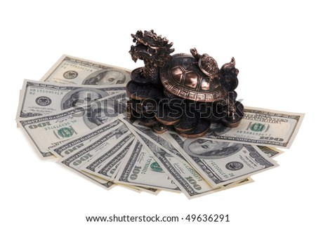 Dragon-turtle with a small turtle shell on the stands on the coins - a symbol of prosperity and success in China. Hundred Dollar Bills. Metal brass. - stock photo