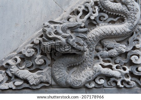 Dragon wall relief - stock photo